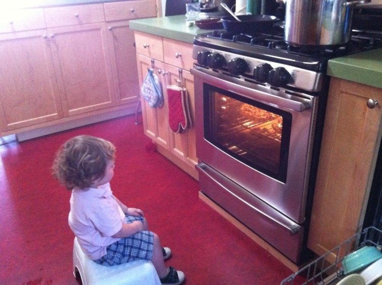 Kid watching oven like it's TV